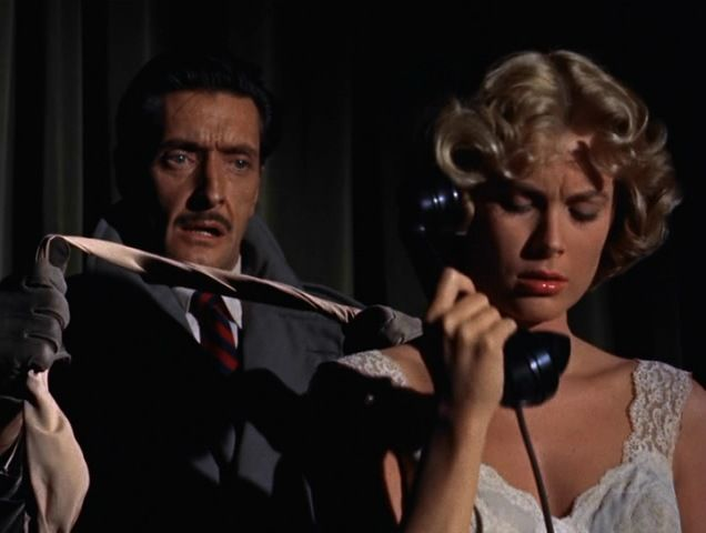"Grace Kelly and Anthony Dawson in Alfred Hitchcock's ""Dial M for Murder."" 1954. An ex-tennis pro carries out a plot to murder his wife. When things go wrong, he improvises a brilliant plan B.:"
