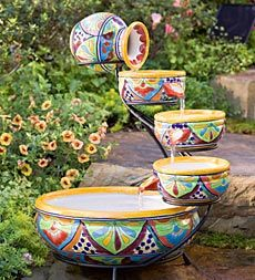 Eight Dish Fountain w/ Light - $449.95 - The sights & sounds of this Talavera fountain lend a festive feeling to porch, patio or sunroom. Glazed ceramic vessels overflow in a continuous cycle of cascading water. Authentic color & design create a low-maintenance display. Handmade in Mexico.