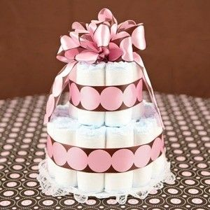 Diaper Cakes are an AWESOME idea for a baby shower! Make them as small or as big as you want!