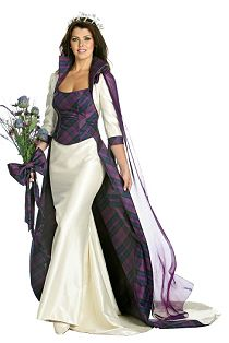Bride with flower and white silk dress with tartan bodice and trim.