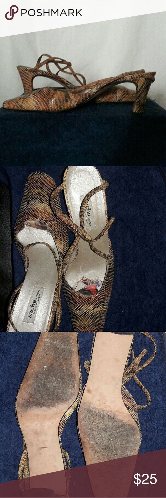 """SACHA snakeskin style strap shoes SACHA snake skin style shoes Two straps go across the foot. The shoes are in vibrant colors in browns with a light sheen. Heel 3"""" Very Good Condition SACHA Shoes Heels"""