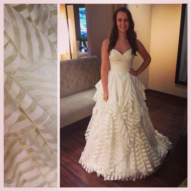 A Striped Wedding Dress With A Flowy Ruffled Skirt From