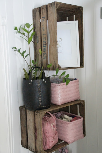 mount crates or other boxes to the wall to become instant shelving w/ a neat look