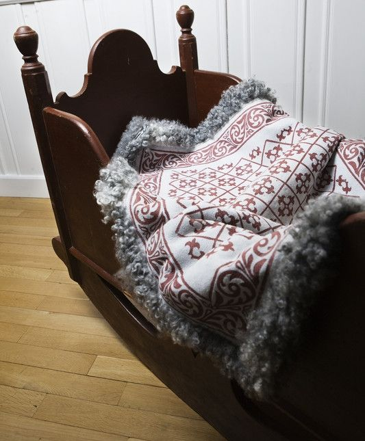 A Norwegian tradition is the use of sheepskin. This baby carpet (Skinnfell) are with printed pattern on one side