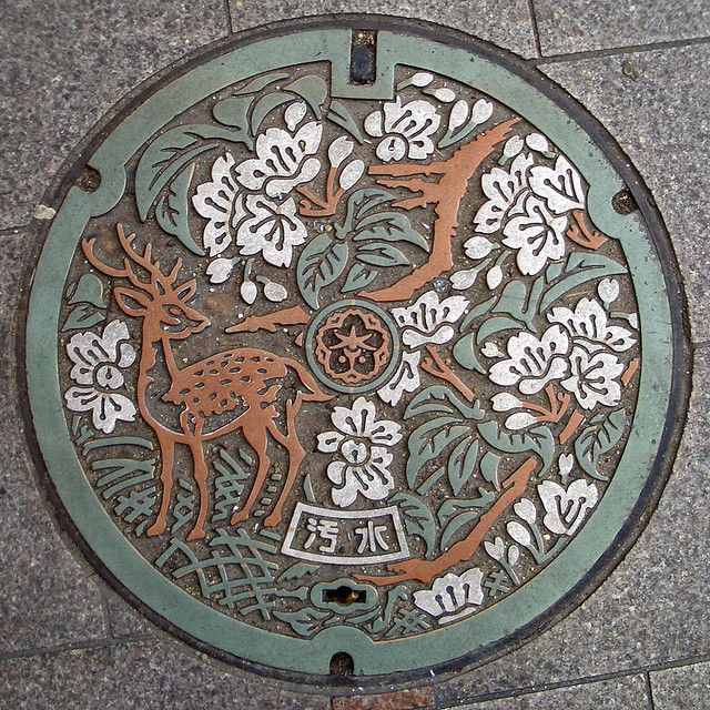 Japanese manhole cover. Image credit Flickr user MovieMichael