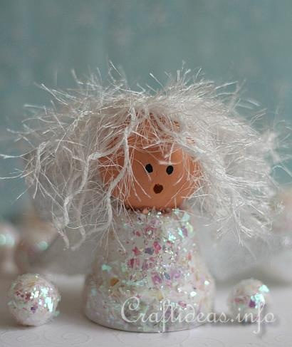 Clay Pot Angel Craft - add wings with paper doily and a halo with sparkly pipe cleaner - kindergarten party