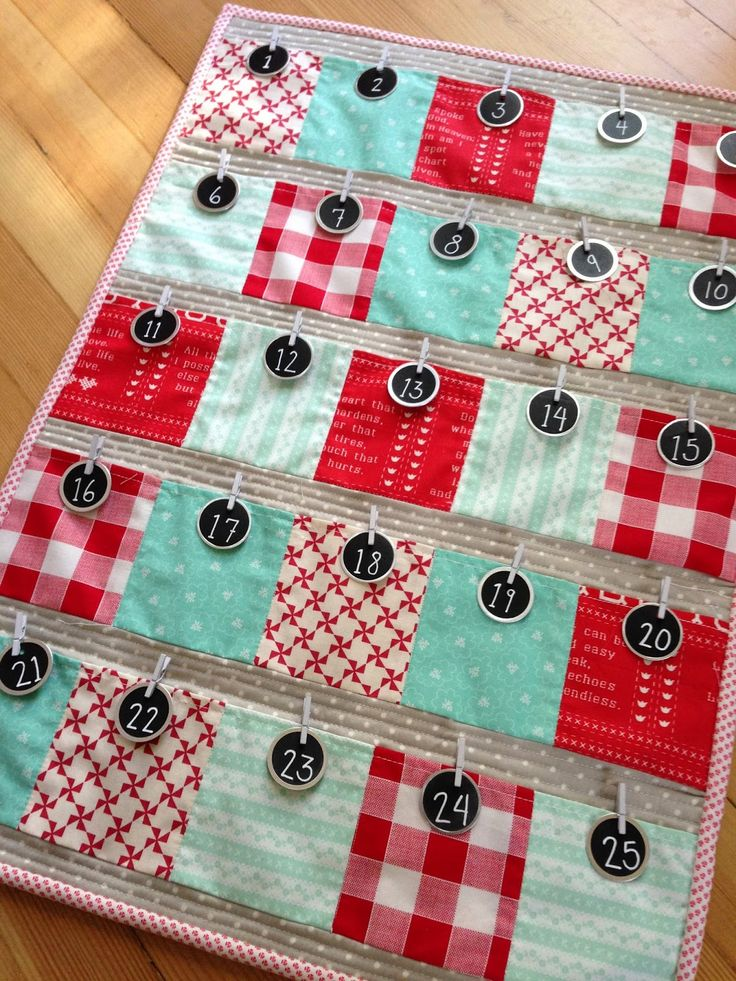 Advent calendar by Quilting in the Rain http://quiltingintherain.blogspot.com/2014/12/december-happenings.html