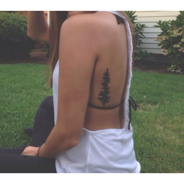 Side piece tattoo of an Oregon fir tree from the state of Oregon license plate. By Aaron Carey at ink daddies in salem.