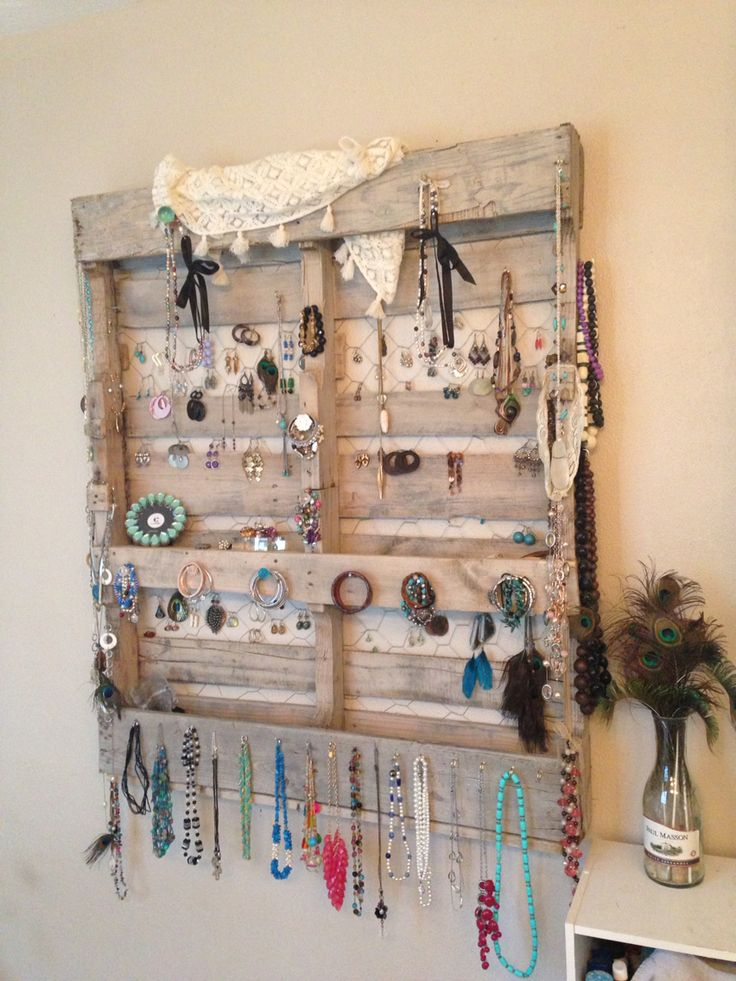 Pallet jewelry organizer. Cut off boards and make shelves. White wash all wood then drill holes for vintage glass knobs and screw in hooks to hold all accessories! Love it!