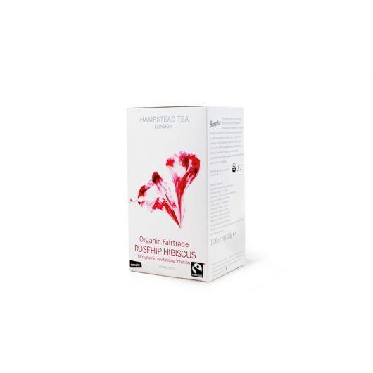 Hampstead Tea | Demeter | Fairtrade Infusão Roseira Brava e Hibiscos Biológica em caixa de 20 saquetas.  Ingredientes: Hibiscos, roseira brava, cascas de laranja e granulado de framboesa de agricultura biológica e comércio justo.  Conheça esta maravilhosa infusão que mistura a roseira brava e o hibiscos, tornando-a numa verdadeira fonte de Vitamina C com excelentes propriedades diuréticas e emagrecedoras.  Modo de preparação: 1 saqueta por chávena de água acabada de ferver (200ml). O tempo…