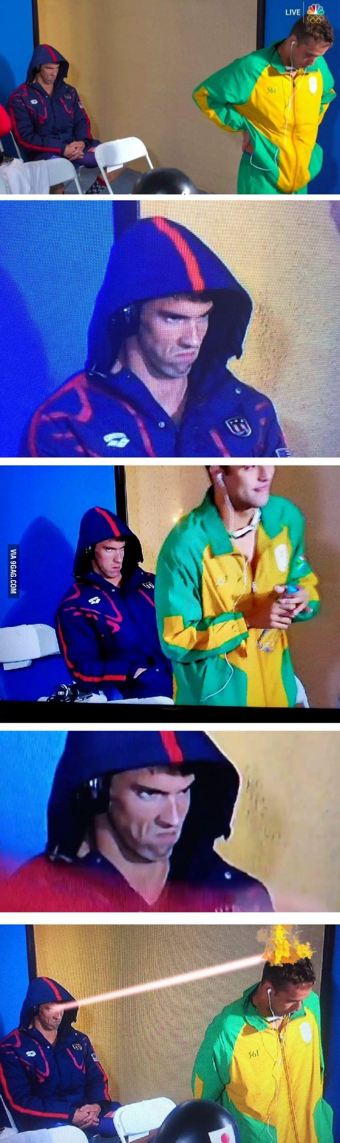 Michael Phelps glowering at his rival Chad Le Clos at the 2016 Olympics - 9GAG