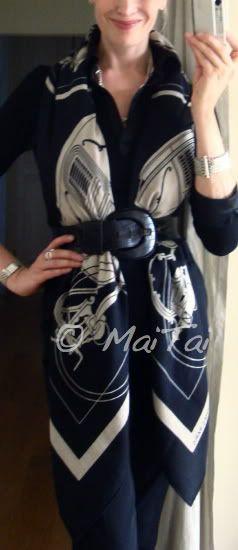 'Ex-Libris' Hermès cashmere shawl secured with a belt