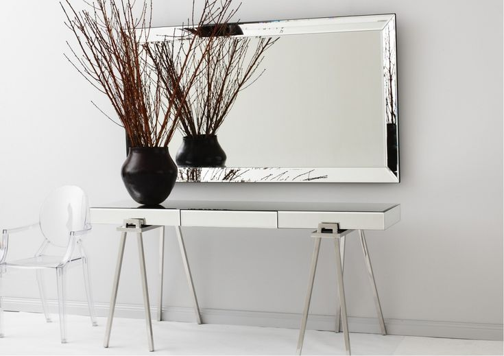 Inspired by individual furniture design, our Trestle Console takes on a sleek, luxe perspective owing to its mirror and polished stainless steel finish. Feature in a formal sitting room with shimmering velvet or silk furnishings and a crystal lamp. Alternatively, use as a desk in a home office, adding a black croc chair, trunk furniture and tripod lamps for accent. Features      Mirrored trestle Console has polished stainless steel trestle style legs with fully mirrored, bevelled top…