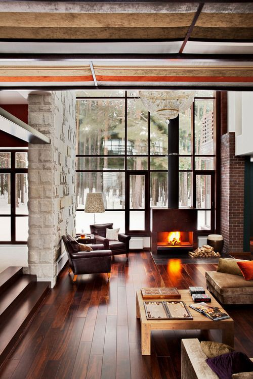 Very nice, modern living room. I love all of the windows for natural light, the fireplace and the wood flooring. It creates a warm and welcome space even when it's cold outside!