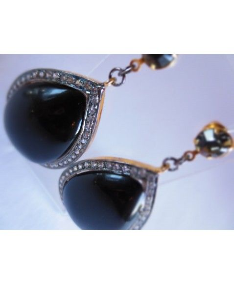 JET BLACK TEAR DROP EARRINGS    Black teardrops encrusted in Swarovski Crystals for a subtle earring, this style is surprisingly light on the ear Designed in WA Earring post is hypo-allergenic Materials include plated brass, hypo-allergenic metal, Acrylic, Swarovski Crystal