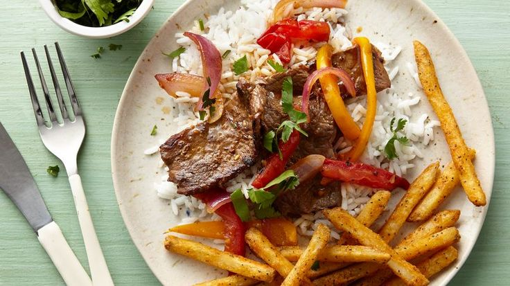 Peruvian Lomo Saltado (stir-fried steak) is an extremely popular fusion dish that mixes the Chinese stir-fry tradition with Peruvian ingredients such as yellow chili pepper, cilantro and tomato. The hearty entree is always accompanied by fluffy white rice and french fries.