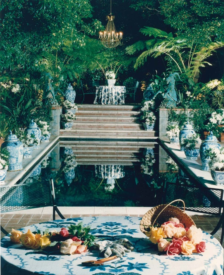 A SWIMMING POOL IN OLD HOLLYWOOD DESIGNED BY HUTTON WILKINSON,, TONY DUQUETTE INC., TO RESEMBLE A VENETIAN CANAL.  NOTE THE 18TH CENTURY ITALIAN CRYSTAL CHANDELIER HANGING FROM THE TREE.