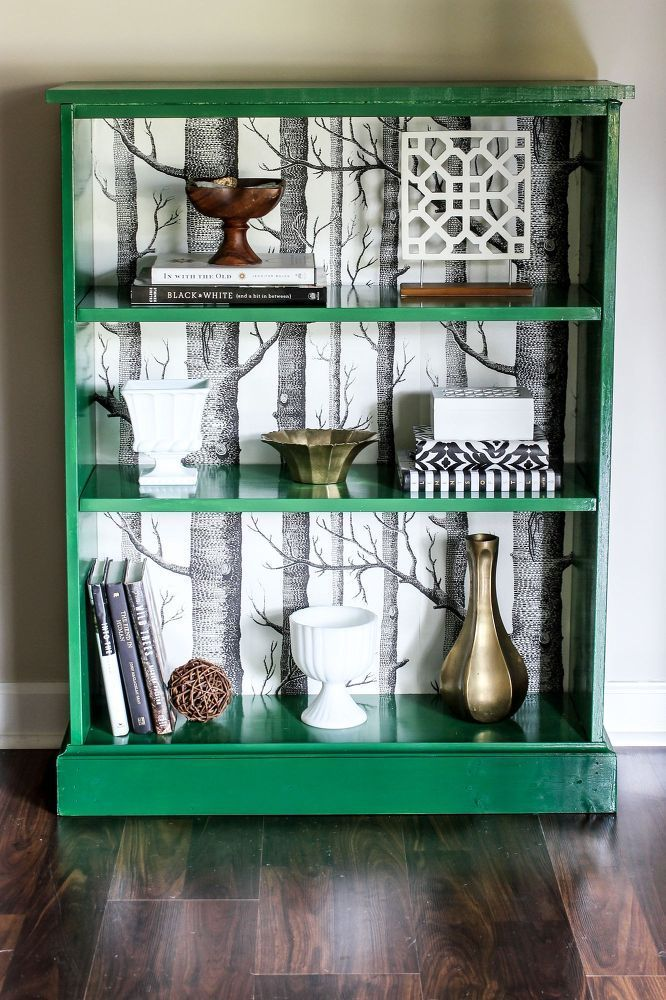 small bookcase makeover with patterned wallpaper for art display cabinet
