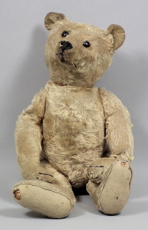 Early Steiff Bear.... uh oh... I have one that looks almost this bad.... 53 years old