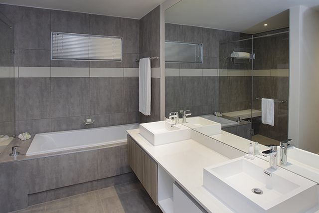 I very, very much need a bathroom with an oversized mirror, obviously.   Empire Executive Apartments & Hotel
