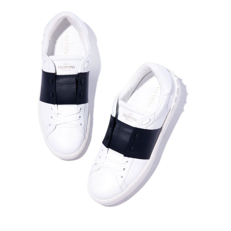 The chic navy stripe is a contrast in texture as well as color on these otherwise clean, crisp white-leather sneakers—it's a modern, polished twist to an otherw
