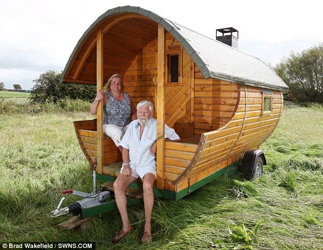 Tony Goulden with his partner Marja Stock and their portable sauna in Glastonbury, Somerset
