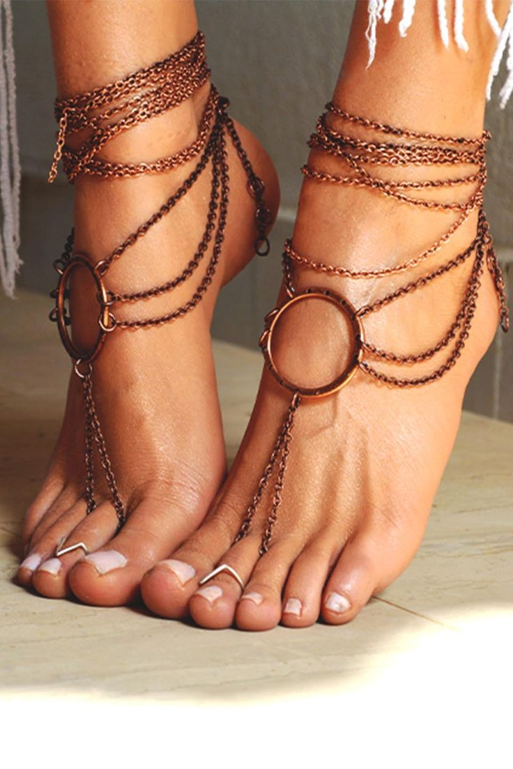 A pair of handcrafted barefoot sandals, with bronze antique chain.   *They have a round bronze metallic charm in the center from where 3 rows of chain are griped until the back of the foot.  *The closure is adjustable. It has a bronze clasp at the back.*   **You can wear them barefoot in the beach or with your favorite pair of sandals even high heels!**  There is an additional multirow chain accompaning the pair of sandal on the foto that is included in the final item you will receive, :...