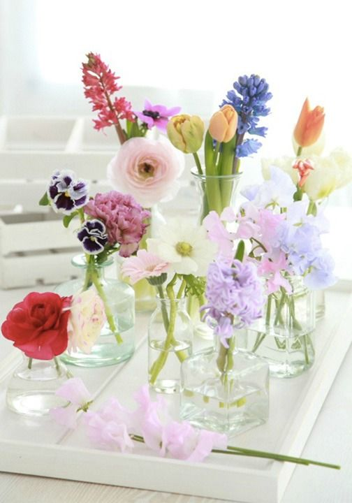 Great flower arrangements aren't necessarily huge bouquets, sometimes the best arrangements are groupings of small vases, some holding only a flower or two.