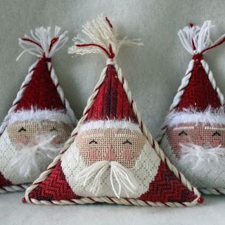 Needlepoint Santas - could adapt this to be a snowman or even a penguin - like the triangle form for something different