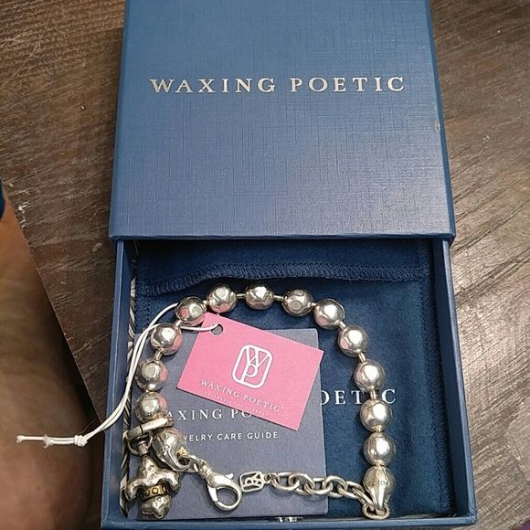 Waxing Poetic Bracelet with a charm Beautiful big bead only worn couple of times Waxing Poetic Jewelry Bracelets