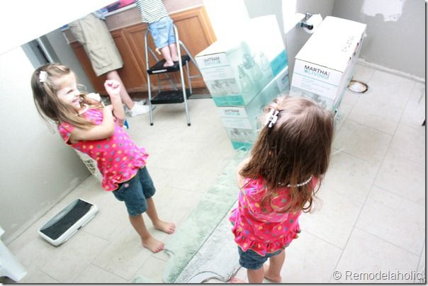 Framing a large bathroom mirror (5)     Ld use this in the retro 1970 yellow bathroom.  Going white cabinet with 20 in width or 18. Mirror across 48' white vanity with stain/woodpro cabinet . Lg mirror with frame and crown molding.  Keeping old floor/great shape and tile/ bathtub.