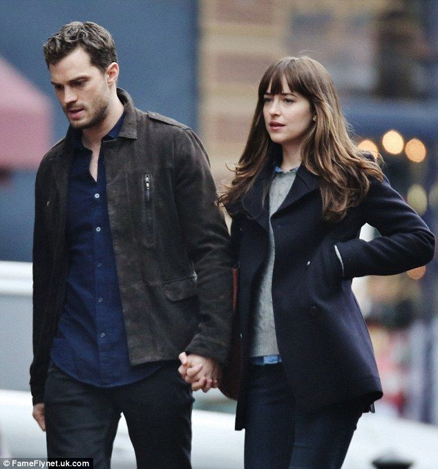 Dakota Johnson and Jamie Dornan are seen holding hands ...