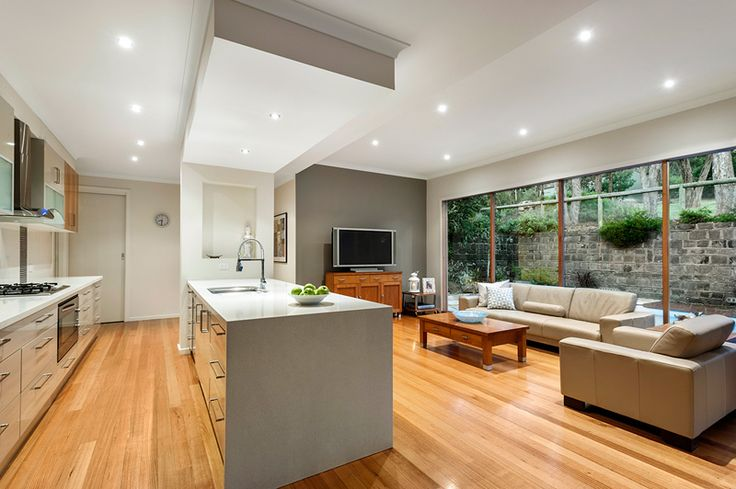 This home puts entertaining to a whole new level.  Open plan kitchen, white benches and polished wood floors.  Barry Plant Eltham.