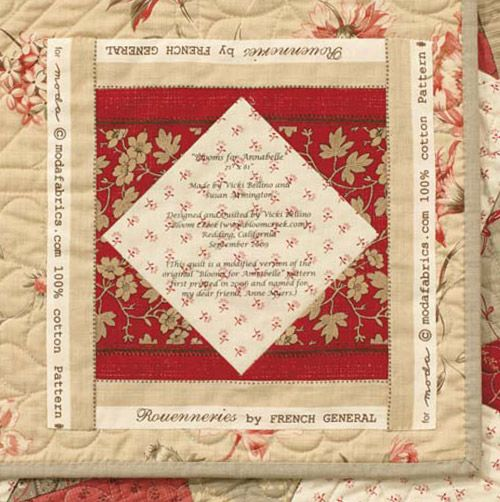I like that on this quilt label they incorporated pieces of the selvages in the border of the label.
