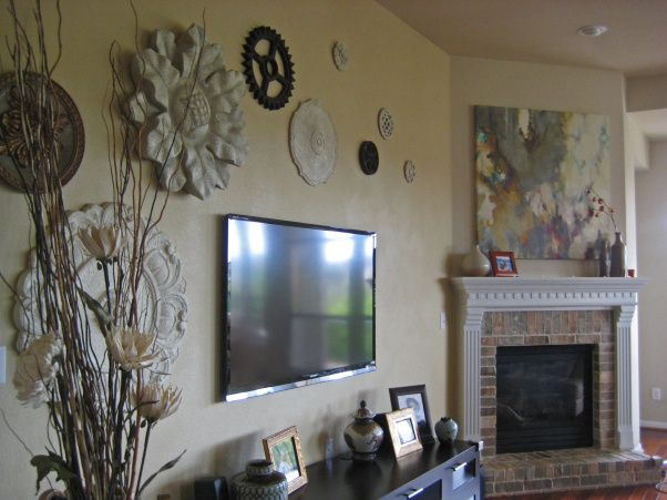 Ceiling medallions make GREAT wall art! Solves boring tv wall problem , Common Problem: The TV WALL!!! Ceiling medallions and other found objects make interesting wall art above wall mounted TV... , Medallions & found objects make fun wall art!  Room designed by Valarie Billings Swayne(Austin, Texas) , Living Rooms Design