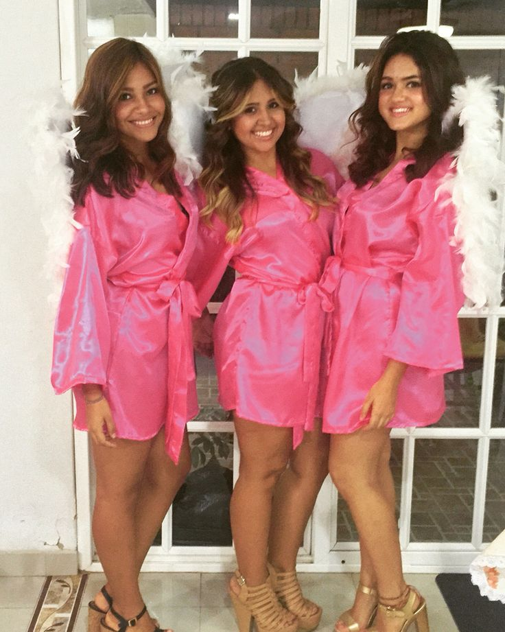 Pink robe, bedazzled with our names, wings and slut heels