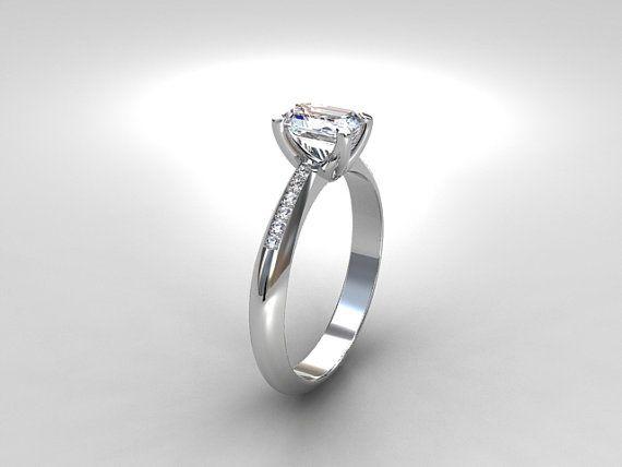 GIA certificated Emerald Cut Diamond solitaire Ring in Platinum