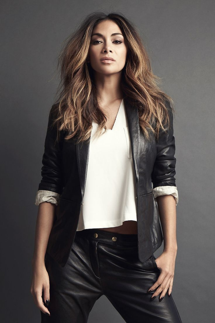 Nicole Scherzinger wearing leather blazer, leather cropped pants, leather jacket.
