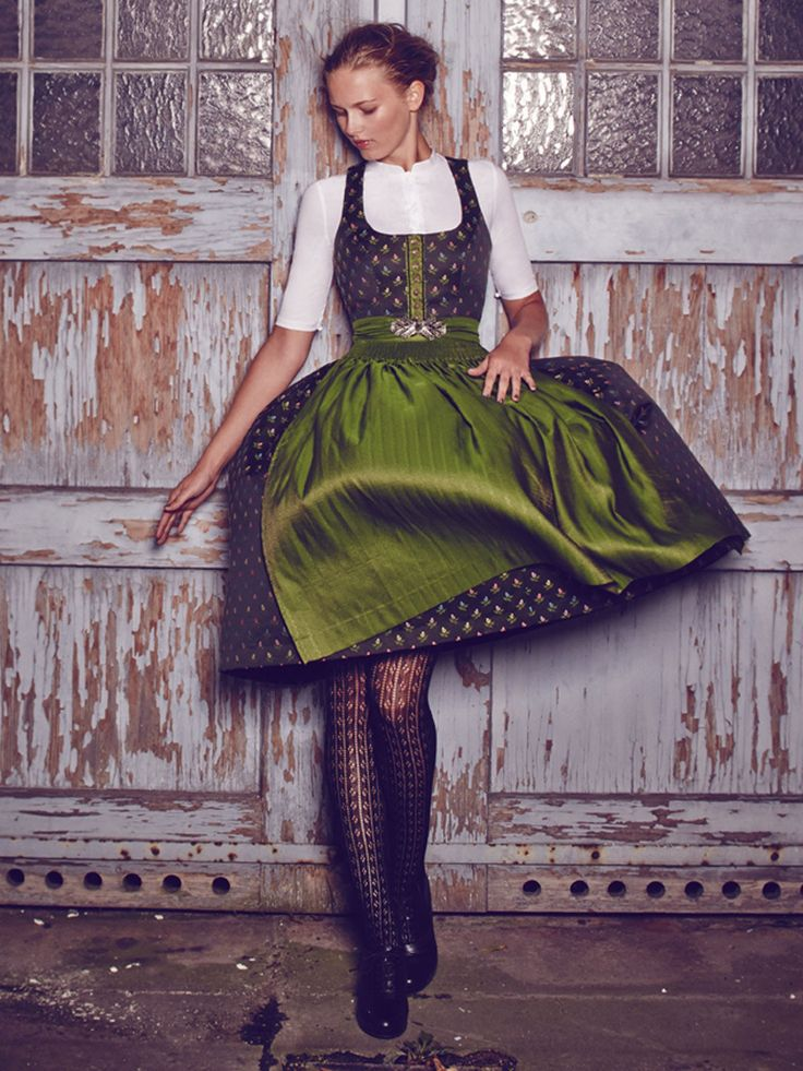 Love the high-neck blouse and decorative tights pairing with dirndl... unexpected yet still feminine and modest.