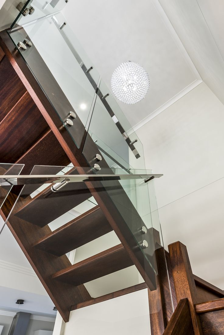Stainless steel stand-offs and handrails on glass balustrade.