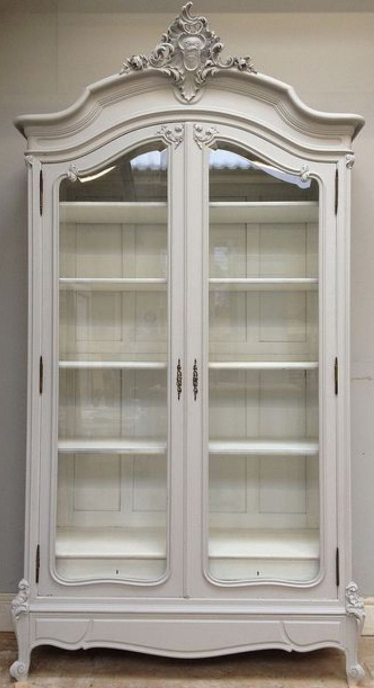 French antique glass-front armoire