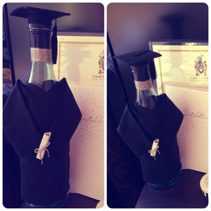 Graduation gift. Gown and hat. Wine bottle.