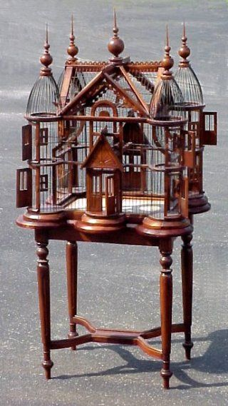 This is a smaller, less intricate bird cage than one I saw in Ballard with Thai designs carved into the walls and base.