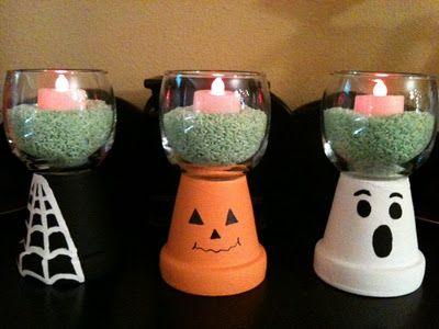 Centros de mesa de Halloween hechos con macetas, velas y cuencos. #DecoracionHalloween