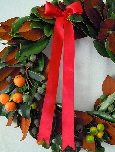 wreath: magnolia leaves, kumquats & eucalyptus pods. #GroveDesign