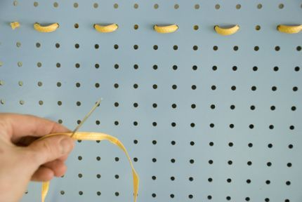 Craftstylish put ribbon through a pegboard.  That would work well for earrings.
