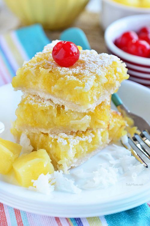 Imagine lounging on a white sandy beach, with these Pina Colada Bars. Enjoy the flavors of coconut and pineapple and consider it your ticket to a mental tropical paradise. grab the recipe at TidyMom.net