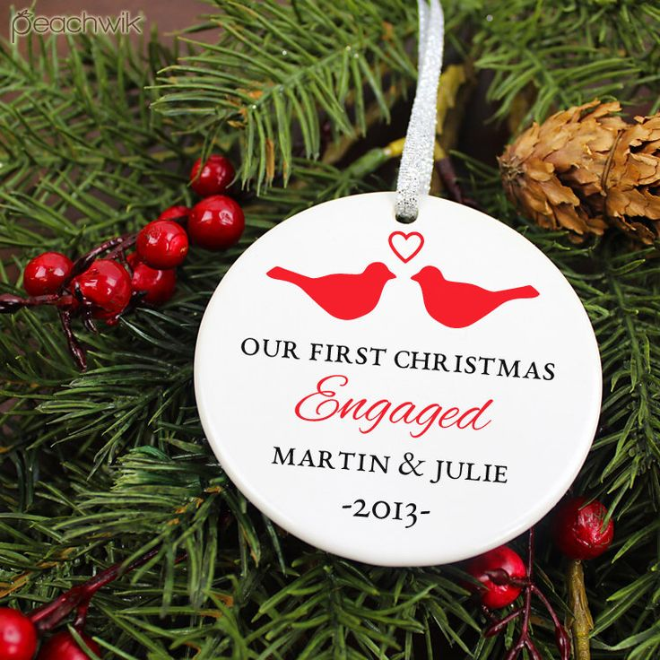 Our First Christmas Engaged Ornament - LoveBirds - Personalized Porcelain Engagement Holiday Gift Ornament - orn147- Peachwik - Custom Color by peachwik on Etsy https://www.etsy.com/listing/166502522/our-first-christmas-engaged-ornament