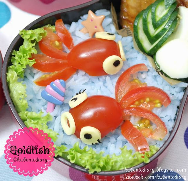 Tomato Goldfish... eyes are made from cheese and nori. Cherry tomato cut in half - one half is the body the other is sliced to make the tail.