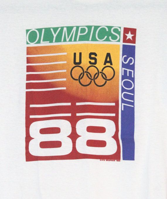 Vintage 1988 Olympics Seoul Graphic T-Shirt *LIKE NEW!* Adult Size Large (Fits Unisex Medium/Large)  This shirt is SUPER soft (50% Polyester, 50% Cotton) like many vintage tees, but the best part is that it looks like it may have been worn only once! It is really like new. There are no defects or stains, and the colors on the t-shirt are vibrant. Message me with any questions!  ---------------------------------------------------------------------------------------------  For more sweatsh...